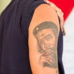 A worker in a tobacco factory proudly shows off his tattoo of Che Guevara.