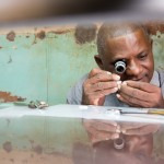 This watchmaker is repairing an old watch. Because of the scarcity of new products in Cuba, everything is repaired and recycled.