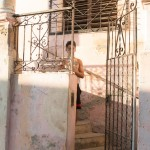 A man behind a wrought iron gate in Santiago.