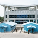 Demilitarized Zone (DMZ) as seen from North Korea with the Freedom House in South Korea across the Armistice Line of Control.  Soldiers from both sides guard the most heavily fortified border in the world.