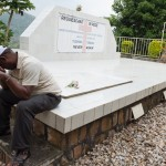 JP mourning his father and family at Kibuye memorial