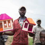 Roadside vendor selling handmade dollhouses