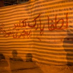 """In Tehran, written in Farsi with crossbones and covered by ominous shadows, this is not a political message but rather a """"No Parking"""" sign."""